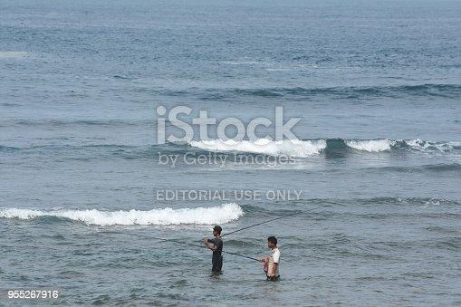 156872766istockphoto fishing on the Watu Karung bech, Pacitan, Indonesia 955267916