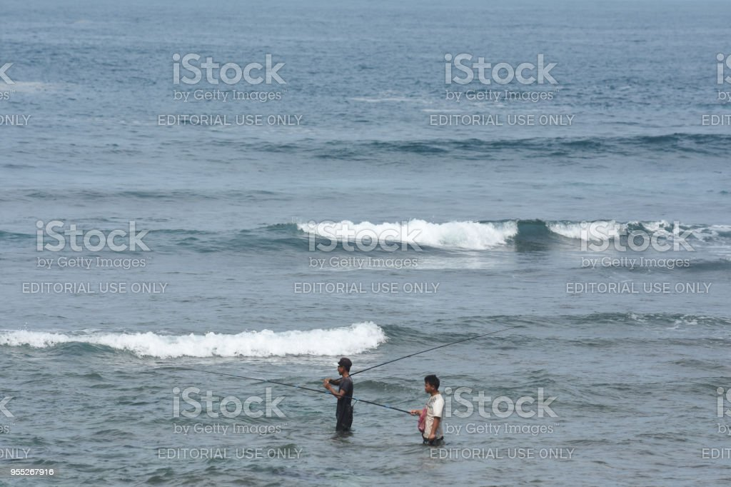 fishing on the Watu Karung bech, Pacitan, Indonesia stock photo
