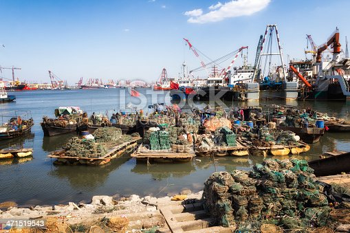 Tianjin, Сhina - April 6, 2013: Fishermen have just finished fishing at Beitang in Tianjing.