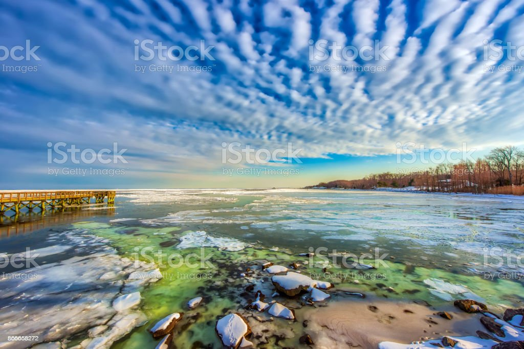 Fishing pier on a frozen Chesapeake Bay in Maryland stock photo