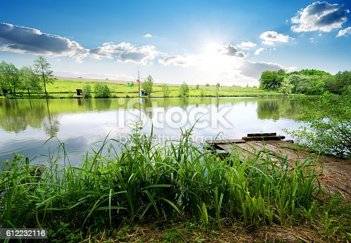 1094918172 istock photo Fishing pier on river 612232116