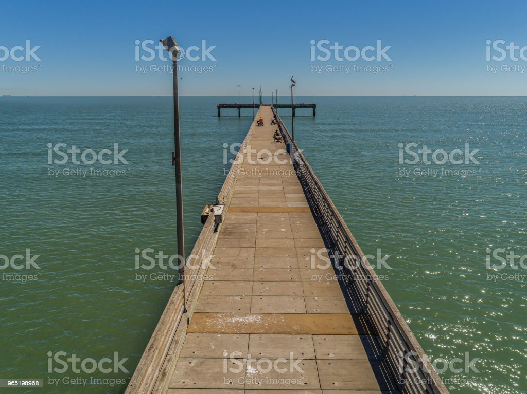 Fishing Pier Over Calm Water royalty-free stock photo