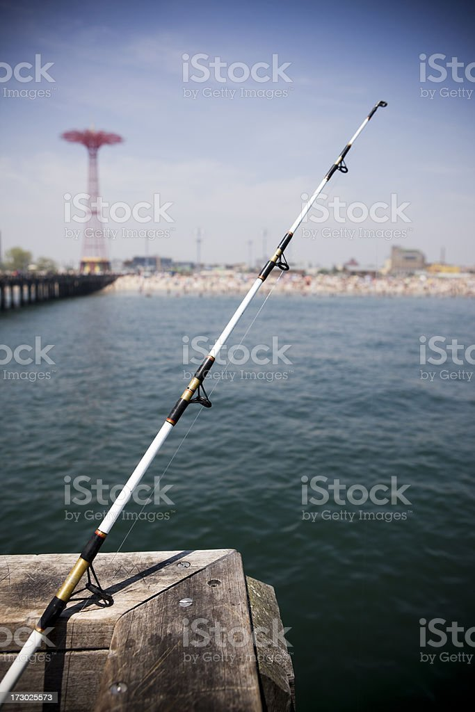 Fishing Pole on Pier, Clear Sky, Long Island Background royalty-free stock photo