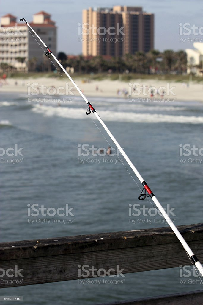 Fishing Pole On Pier royalty-free stock photo