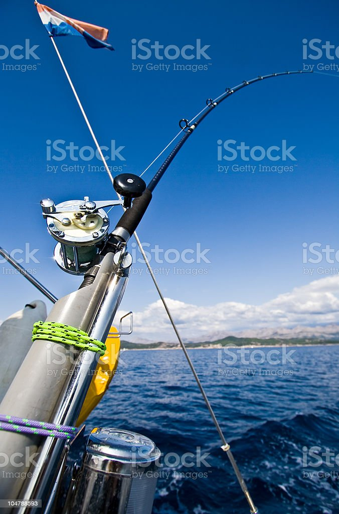 Fishing pole over the water royalty-free stock photo