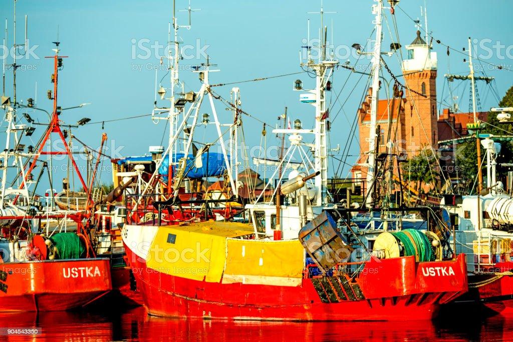 Fishing port of Ustka, Poland with old lighthouse stock photo