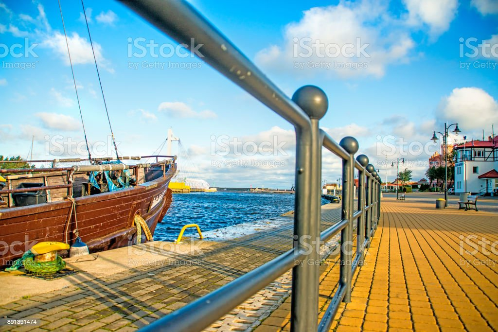 Fishing port of Ustka, Poland with old sail boat stock photo