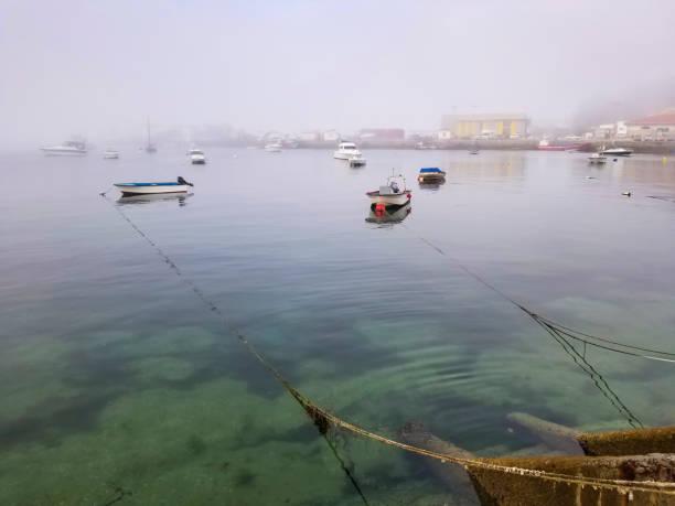 Fishing pòrt on the fog stock photo