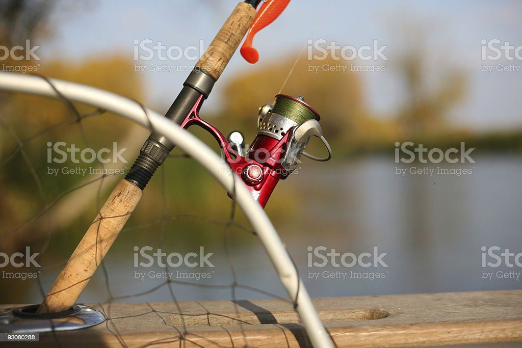 Fishing reel and a silicon lure royalty-free stock photo