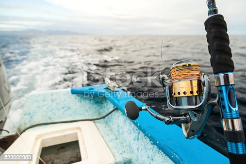 156872766istockphoto Fishing Reel and Rod on Boat Close Up 523002353