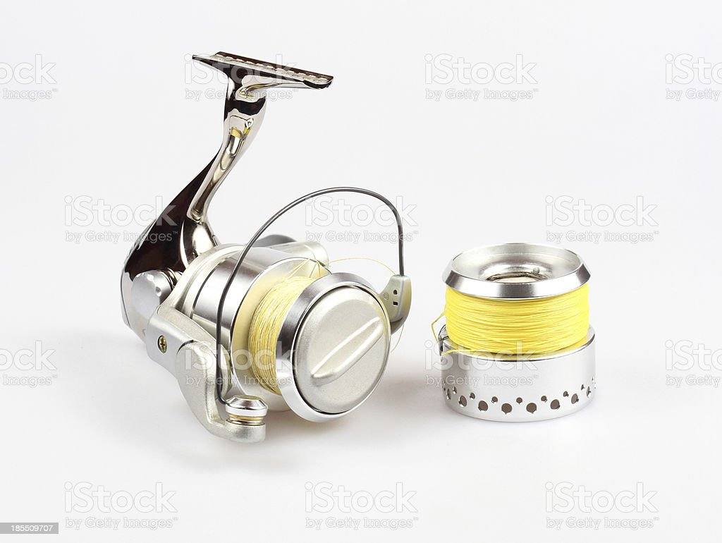 fishing reel on white background royalty-free stock photo