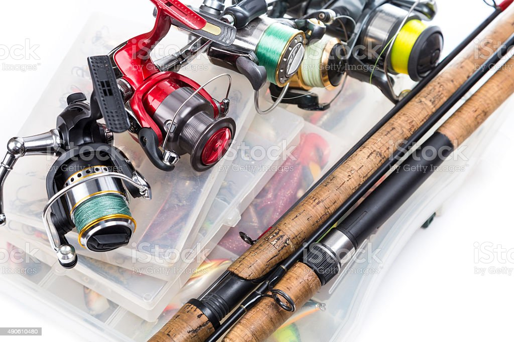 fishing reels and rods on storage boxes stock photo