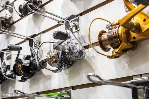istock fishing reels of different sizes on the counter in the fishing store 1226396195