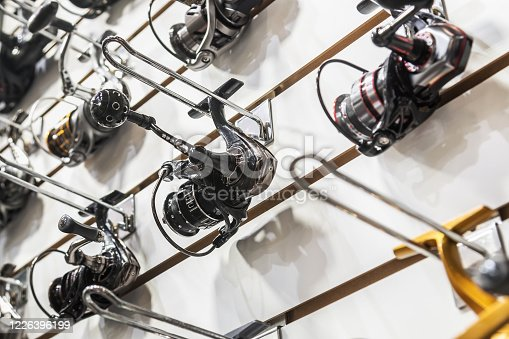 istock fishing reels of different sizes on the counter in the fishing store 1226396199