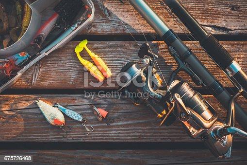 istock fishing rod and baits 675726468