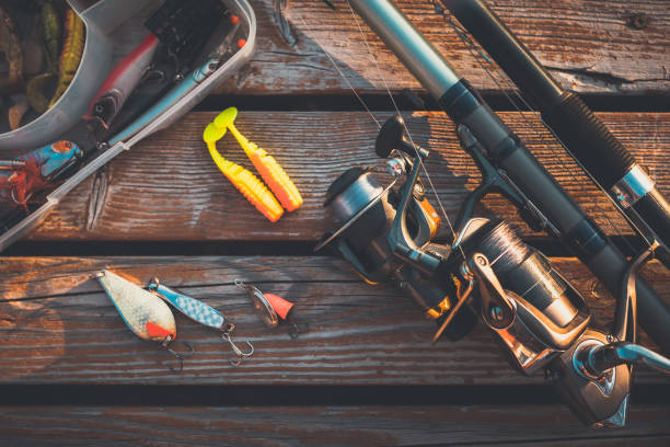 fishing rod and baits fishing rod and baits freshwater fishing stock pictures, royalty-free photos & images