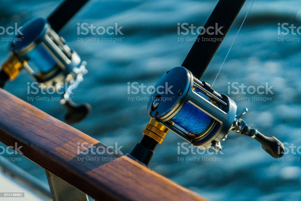 Fishing rod and reel on boat stock photo