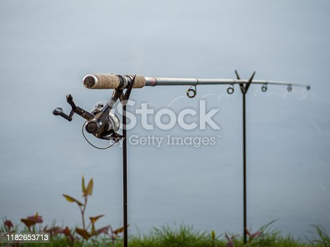 1094918172 istock photo Fishing rod in the lake 1182653713