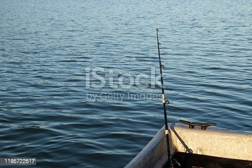1094918172 istock photo A fishing rod inside a boat. Outdoor recreation and leisure concept image. 1195722517