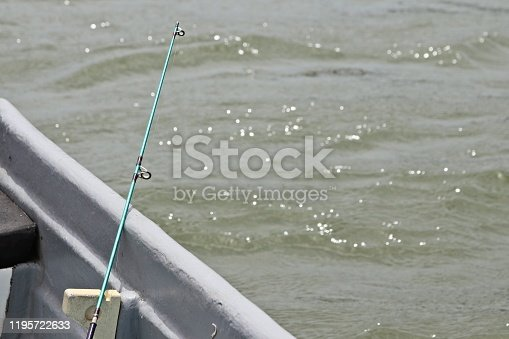 1094918172 istock photo A fishing rod inside a boat. Outdoor recreation and leisure concept image. 1195722633
