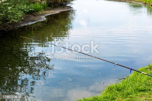 1094918172 istock photo Fishing rod on the river. 1245212670