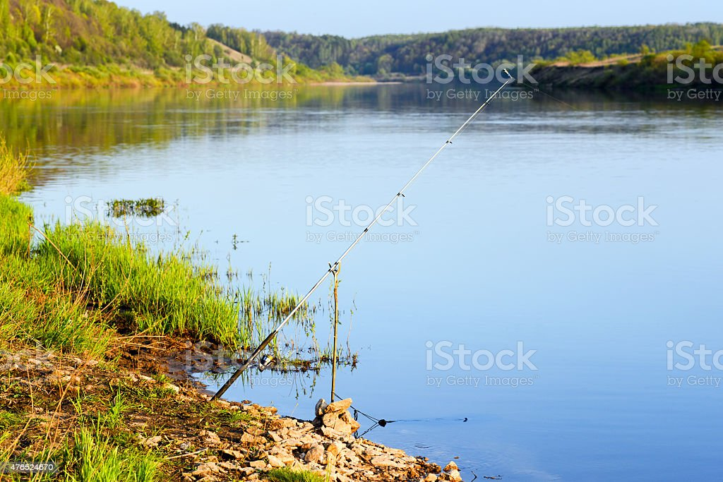 fishing rod on the river stock photo