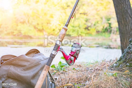 1094918172 istock photo Fishing rod with spinning reel 850142346