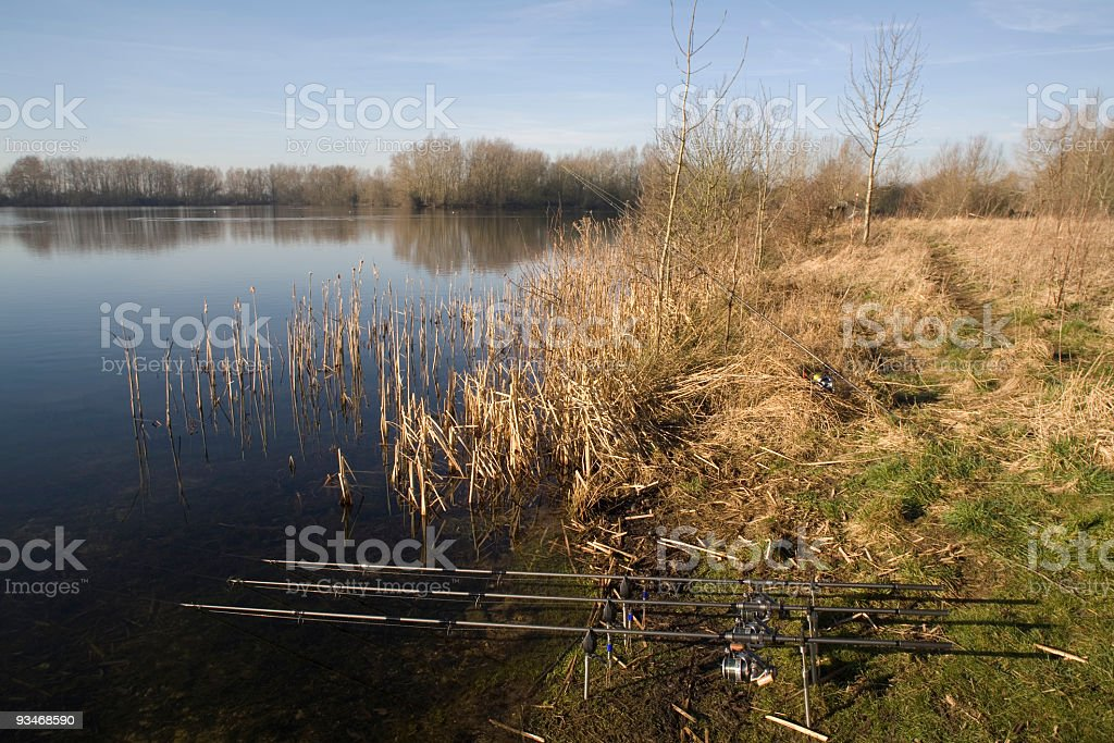 fishing rods at lake royalty-free stock photo