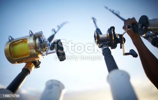 istock Fishing rods early in the morning 149074756