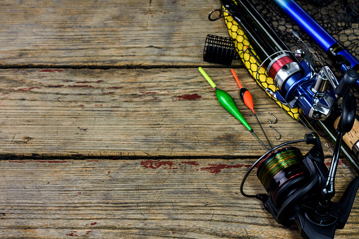 istock Fishing rods on wooden table 1264876185