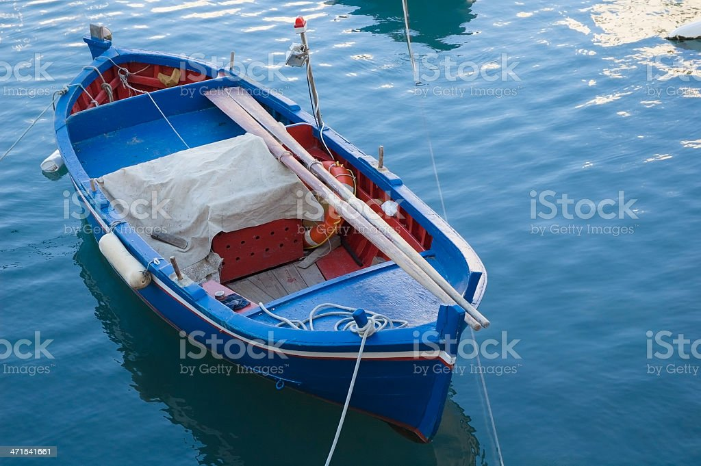 Fishing rowboat (gozzo) in little port of Giovinazzo, Bari stock photo