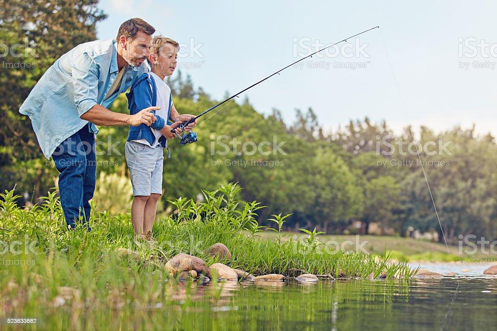 Fishing runs in the family stock photo