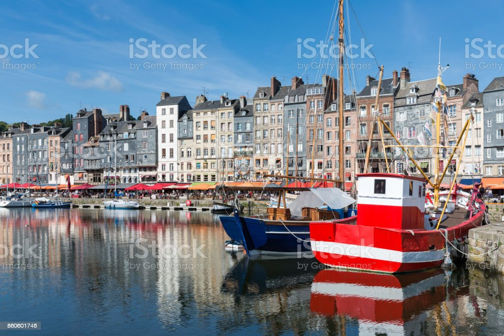 Fishing ship in old medieval harbor Honfleur, France stock photo