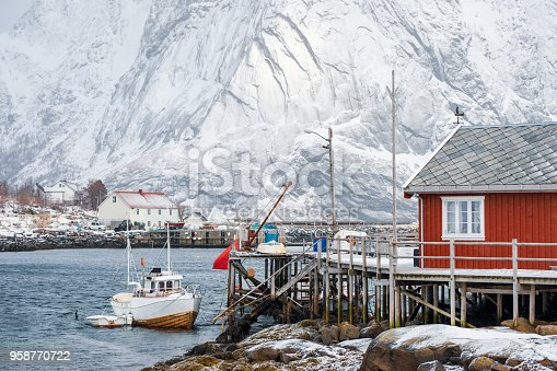 Fishing ship moored on wooden jetty in fishing village on lofoten islands