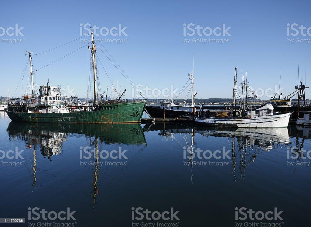 Fishing ships docked in the bay at Newport, Oregon royalty-free stock photo