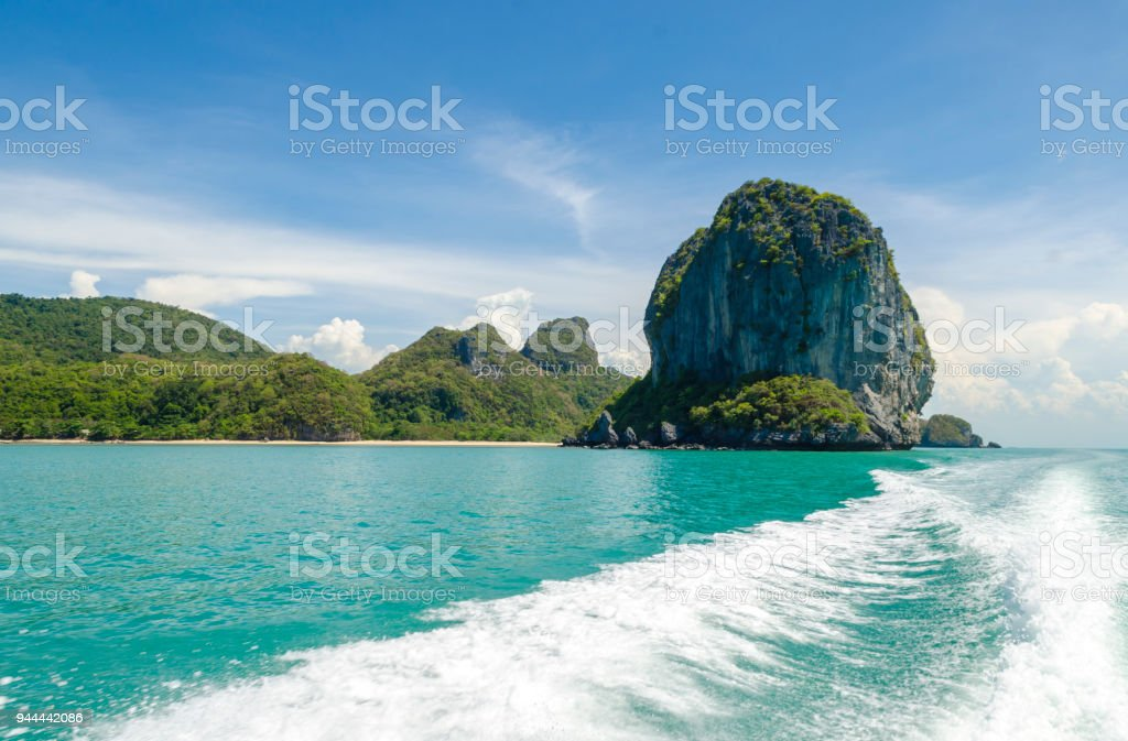 Fishing speedy boat prop wash, white wake on the blue ocean sea stock photo