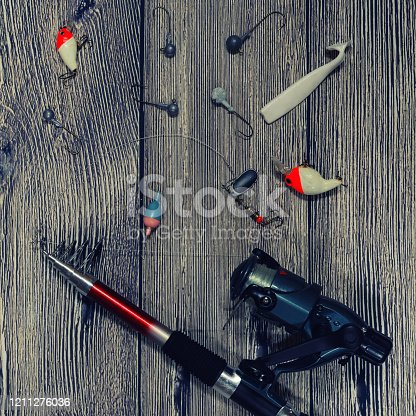 864720746 istock photo fishing spinning, hooks and lures on wooden background 1211276036