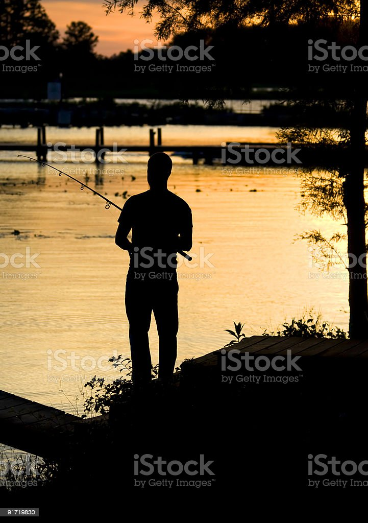 Fishing sunset silhouette royalty-free stock photo
