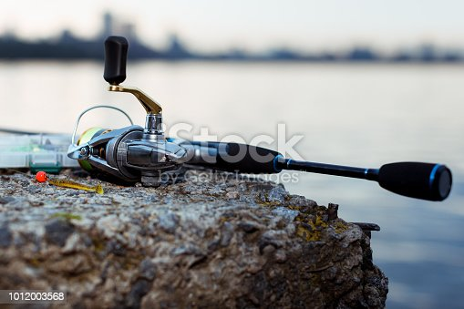 864720746istockphoto Fishing tackle. fishing spinning, hooks and lures 1012003568