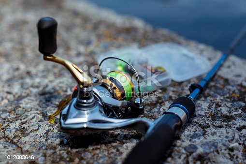 864720746istockphoto Fishing tackle. fishing spinning, hooks and lures 1012003646