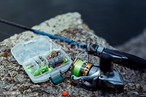 864720746 istock photo Fishing tackle. fishing spinning, hooks and lures 1013796184