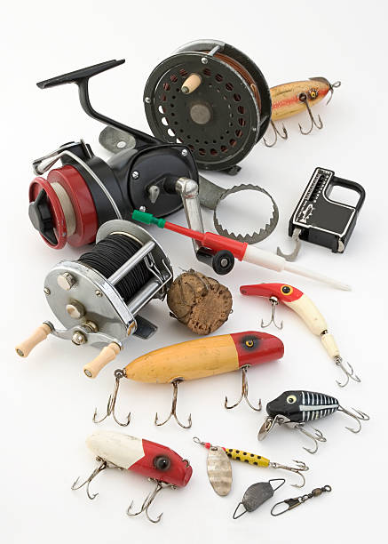 Fishing tackle objects displayed on a white background stock photo