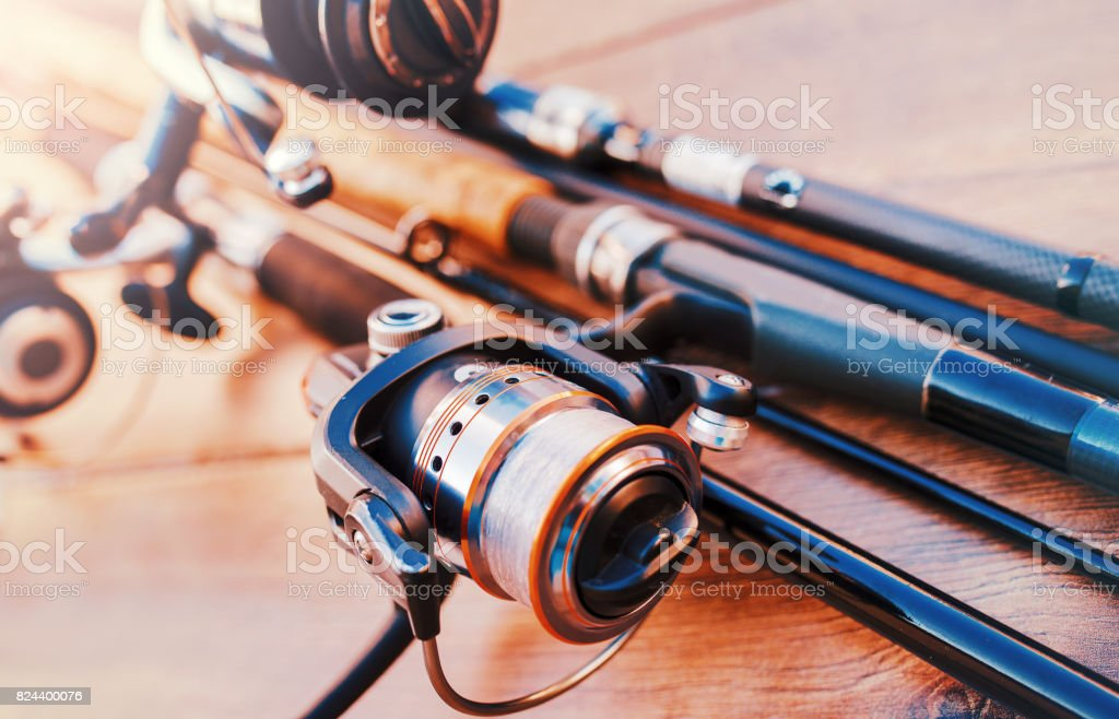 Fishing tackle on a old wooden table. Sport and recreation concept stock photo