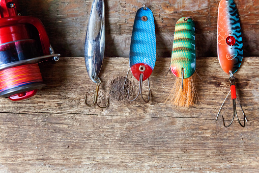 istock fishing tackle on a wooden surface 842972990