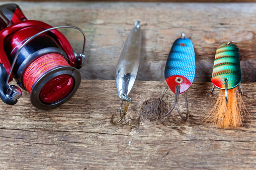 istock fishing tackle on a wooden surface 842973090