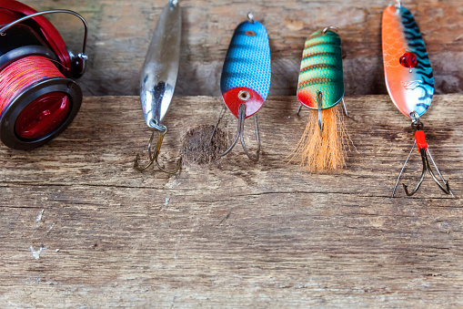 istock fishing tackle on a wooden surface 842975122