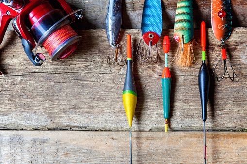 istock fishing tackle on a wooden surface 842975158