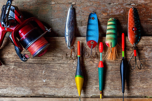 istock fishing tackle on a wooden surface 842975198