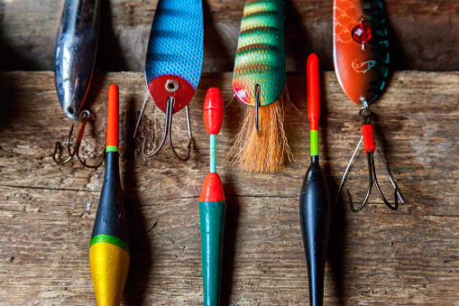 istock fishing tackle on a wooden surface 842975244