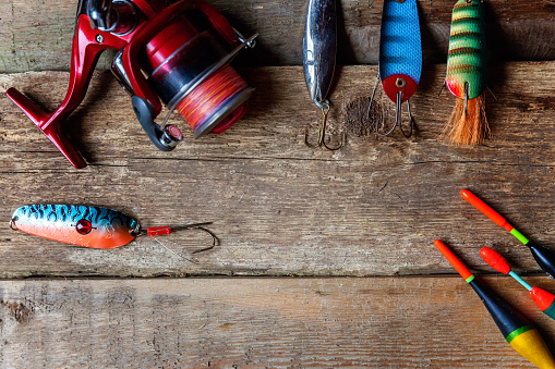 istock fishing tackle on a wooden surface 842975292